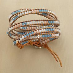 Periwinkle pops among the soft shimmer of white jade and quartz in this lattice-woven bracelet from Chan Luu.