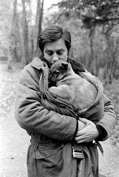 Alain Delon comforts a puppy