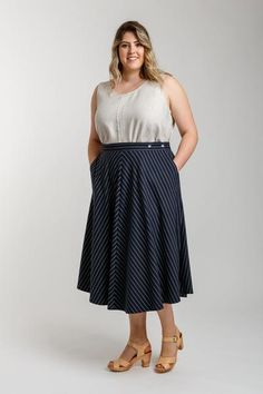 Wattle is a set of classic skirts with unique crossover closure at the side seam. Pattern sits on the natural waist and features hidden closure at the left pocket, three skirt options, slash pockets, two waistband options and multiple lengths. View A is a bias cut midi length skirt. View B is a skirt pleated above the