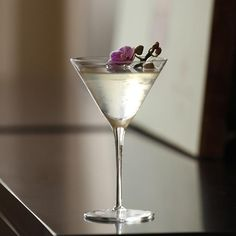 The white Cosmo cocktail - vodka, elderflower, white cranberry juice and lime. Shake and pour into a martini glass.. enjoy!