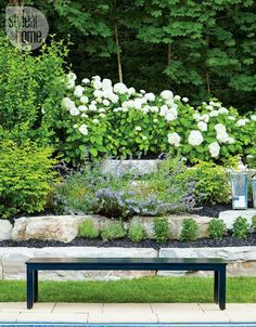 Garden bench—A raised flowerbed edged with large rocks creates a seamless transition from garden to forest. Amidst the fresh, airy wonder is a sleek black bench to sit and smell the flowers. Flower Bed Edging, Garden Edging, Garden Borders, Flower Beds, Garden Pool, Glass Garden, Moon Garden, Dream Garden, Les Hamptons