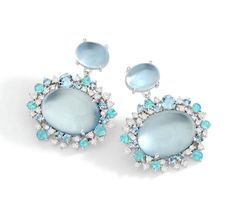 Earrings in 18k white gold with round diamonds, aquamarine and parahyba…