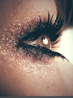 a different version of the smokey eye; dark mascara and eyeshadow; with glitters all over.