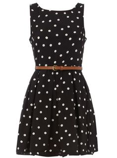 Black polka dot belted dress. I'd pair it with a bright sweater and wear the belt outside on the waist