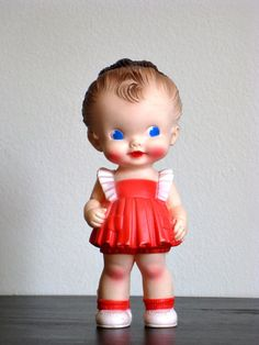I had a little squeaky doll just like this but with a blue dress - one of my first dolls