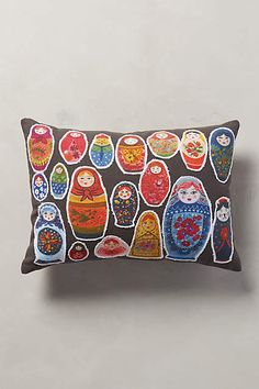 Stamped Curiosity Pillow - anthropologie.com. I like the Russian Dolls or the Playing Cards pillow