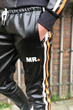 Tracksuit pants orange stripes by Mr Riegillio Puños 949a9096ace0d
