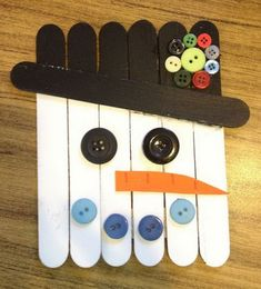 Snowman Made from Sticks and Buttons