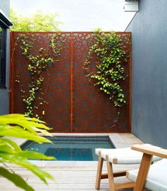 Spotted gum decking and laser-cut rusted steel add textural complexity to this courtyard.