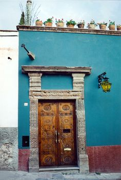 wooden door in a colorful house