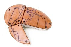 """Of The Serie Mending bodies on the map"" by Carolina Gimono. 2009. Copper, Silver, Vitreous Enamel, textile."