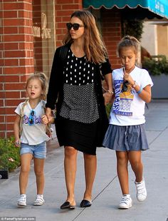 Mom chic: Jessica looked every bit the mom in a casual, loose fit black and white print dr...