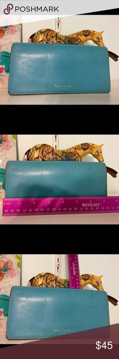 Blue Kate Spade Wallet Blue / Tan Kate Spade Wallet ♠️ Wallet is scuffed as you can see in the pictures above, still has lots of life left, such a beautiful color! ♠️ 🦄Reasonable Offerers Welcome🦄 kate spade Bags Wallets