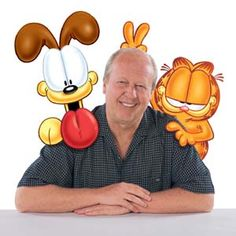 Jim Davis was born in Marion, Indiana, and grew up on a small farm in Fairmount, Indiana, with his parents and brother and 25 cats. Davis's childhood on a farm parallels the life of Garfield's owner, Jon Arbuckle, who was also raised on a farm with his parents and a brother, Doc Boy. Davis attended Ball State University and was a member of the Theta Xi fraternity. Davis resides in Albany, Indiana