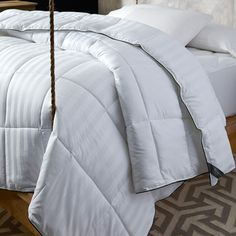 Wrap yourself up on chilly nights with this timeless comforter, showcasing a subtle stripe motif in white.  Product: Comforter