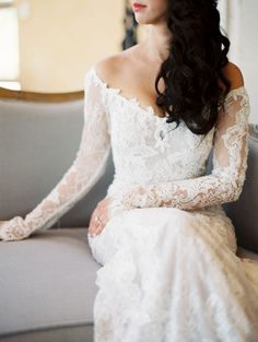 off-the-shoulder long lace sleeve wedding gown