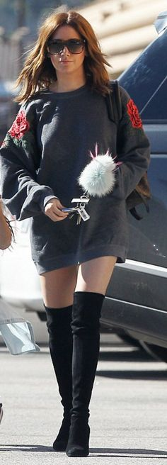 Who made  Ashley Tisdale's gray rose print sweatshirt, key chain, and black suede thigh boots?