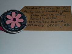 Pillsbury's Pieces No, 193. Pin with teal metallic capsule with pink flower. In exchange for a donation to KATHMANDU ANIMAL TREATMENT CENTRE, Nepal. Available at St. George's Church, Madrid on Saturday 13 June from 11.00 - 15.00.