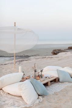 Beach wedding decor - lace, a wooden pallet and comfy cushions for relaxed lounging | Maria Sundin Photography | Bridal Musings