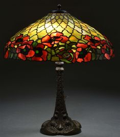 Duffner & Kimberly table lamp has a leaded glass shade with a band of bright red poppies surrounding the bottom of th. on Dec 2018 Stained Glass Lamps, Leaded Glass, Antique Lamps, Arts And Crafts Movement, Red Poppies, Art Decor, Home Decor, Art Day, Glass Shades