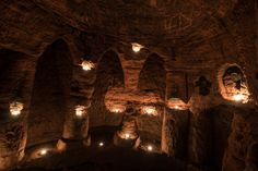 PIC BY Michael Scott/ Caters News - (PICTURED: The candle lit cave) - It might look like an ordinary rabbits hole, but this tunnel unearths a stunning CAVE. The unassuming hole reveals a cave which is hidden less than a metre beneath a farmers field. The untouched caves, in Shropshire, date back 700 years when they were used by the Knights Templars - a medieval religious order that fought in the Crusades. Photographer Michael Scott, from Birmingham, set out in search of the historical…