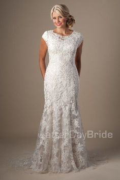 Zinnia | Glow with bridal beauty in this lovely lace gown complete with illusion bateau neckline, mermaid silhouette and stunning color.    Gown available in Cafe/Ivory/Silver, Ivory/Silver or White/Silver.    *Gown pictured in Cafe/Ivory/Silver    LatterDayBride | Modest Wedding Dress| SLC | Salt Lake City | Utah | UT | LDS |