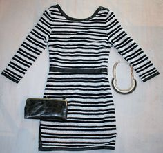 Saturday Chris Brown Concert  Black and White ¾ Length Striped Dress with Leather Accents by Tart $143 Short Black and Cream Leather GoldStatement Necklace by Golden Stella $46 Black Distressed Wallet by Latico $46