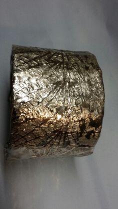 Titanium open bangle. Artificial light.