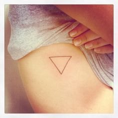 Triangle tattoo- something what would be so significant to me standing for two things; the father, the som, and the Holy Spirit. Also signifies the three parts to a marriage. God (at the top point signifying the focus) him and her at the other two. Three parts