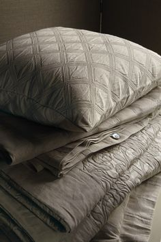 The luxury of pure linen & silk. Easy, earthy colours. Patterns that recall entwining plants and leaves. Nothing is as effortlessly stylish as these quilts and covers by Frette. PURITY – FR4351 PLATINUM Yarn-dyed linen and silk duvet cover. $ 2.200 PURITY –  PLATINUM Yarn-dyed mixed linen and silk bedspread.  PURITY –INTARSIO Yarn-dyed mixed linen and silk cushion.  http://www.frette.com/platinum#