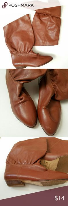 Vintage Cognac Brown Leather Mid Calf Riding Boots Cognac brown riding style boots. Low stacked heel. Mid calf shaft height. Vintage but in excellent condition; wear is on the bottom and minor scuffing at the toe (as pictured). Size 6. Made in Brazil. Shoes Heeled Boots