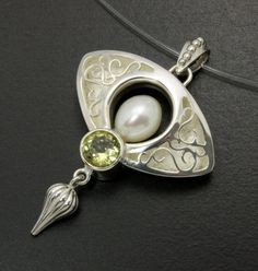 Arabesque open work silver pendant with yellow quartz by KAZNESQ, $148.00