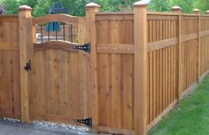 Fence and Gate with Iron insert By Frontier Fencing & Decks Inc.