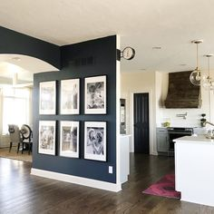 The walls are painted in Valspar's Night View – my favorite deep navy/moody color right now. The walls are painted in Valspar's Night View – my favorite deep navy/moody color r Home Living Room, Living Room Decor, Living Spaces, Large Living Rooms, Kitchen Living, Room Kitchen, Sweet Home, Diy Casa, Style At Home