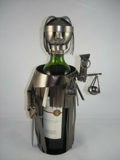 Lady Justice Metal Wine Bottle Holder by China. Save 40 Off!. $29.99. Lady Justice Metal Wine Holder. Decotative piece is perfect gift to persent a bottle of wine.. Highest quality Iron and Metal with plated black Nikel on surface.. Each piece is uniqulized and reflects personality for a better gift experience. Contemporary decorative metal wine holder simple but elegent.. Lady Justice Metal Wine Holder