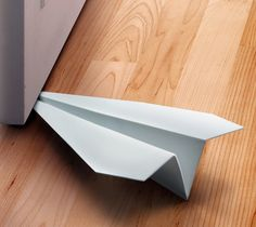 If you've ever flown paper airplanes, then you know where they all eventually land – yes, wedged under your door.