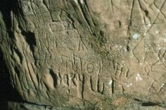 A closeup of the traditional Cherokee symbols and what may be the oldest known writing of Sequoyah in the rockshelter thought to be the grave site of Red Bird. From K. B. Tankersley's Kentucky Cherokee: People of the Cave.
