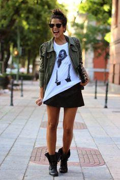 street style black skirt t shirt military jacket combat boots messy bun sunglasses