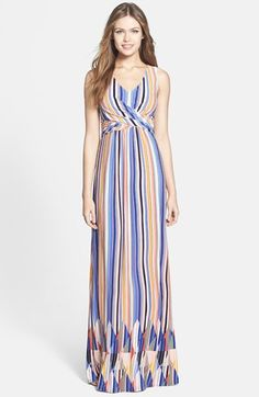 Jessica Simpson Cutout Back V-Neck Print Jersey Maxi Dress available at #Nordstrom. Long vertical lines lengthen the body and the twist at the waist brings curves and proportion.