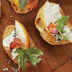 Pear-and-Blue Cheese Crostini | The arugula, cheese, and bacon pair perfectly with the sweet fruit. | SouthernLiving.com