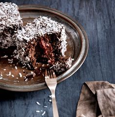 Triple-Chocolate Lamingtons ~ the traditional butter cake has been swapped for chocolate cake in these lamingtons, and the stakes raised with a chocolate cream and raspberry jam. Sweets Recipes, Just Desserts, Yummy Eats, Yummy Food, Tasty, Lithuanian Recipes, Beautiful Desserts, Chocolate Recipes, Chocolate Chocolate