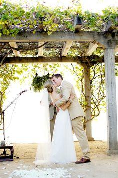 style me pretty - real wedding - usa - california - santa barabara wedding - santa barbara historical museum - bride & groom - ceremony - first kiss