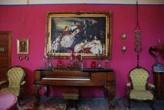 This is another view of the Music Room, second parlor, looking North.  Rosewood square grand piano, Wm Knabe & Co., Baltimore, circa 1873.  Grapes carved on the piano legs.  Flanked by a pair of gentlemen's chairs, circa 1850, Rococo Revival. Painting oil on canvas, 1864, Queen Victoria, Prince Albert, and five of their children.  Painted by Francis Xavier Winterhalter (Oceans Bridge).  American girondol three piece set, circa 1830's. Russian enamel candle set, Rococo Revival.