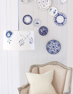 Pattern Play    Elevate classic blue-and-white plates from a spot at the table to a place on the wall. Then lift the motifs right off the pottery and onto other household items that could use a decorative edge, as done with this plain lampshade adorned with paper cutouts of Royal Copenhagen's Blue Fluted Mega pattern.