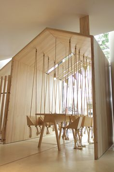 Fii Fun House | A cafe with swings, playrooms and tables with coloured pencil holders