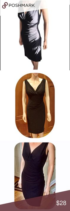 Stunning Black Sleeveless Faux Wrap Dress This stunning black sleeveless faux wrap dress is the perfect LBD. LaFell wrapped up creates a V neck, defining the bust area & creating a flattering silhouette. Below the bust, the dress is ruched on the left side, creating slight draping that helps with any problem area. The bottom left side of the dress has a slit, revealing a layer underneath, as if it actually is a wrap dress. The dress has stretch to it. The dress is gently pre-loved, in…