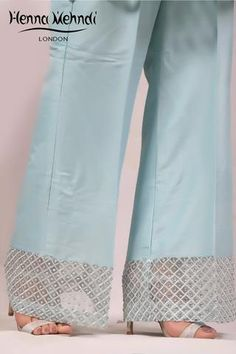 Teal raw silk trousers with diamanté embellishment. Available in trousers, cigarette trousers or boot cut trousers. Please note these are trousers only. Salwar Designs, Kurti Neck Designs, Kurti Designs Party Wear, Blouse Designs, Trousers Women, Pants For Women, Clothes For Women, Ladies Pants, Leggings Fashion