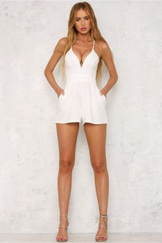 The Dream On Playsuit features a plunging V neckline, a racer-style back and shorts with pockets on either side. There is also an invisible zip for easy access. Style this cute piece with nude pumps!   Playsuit. Partially lined. Cold hand wash only. Model is standard XS and is wearing XS. True to size. Stretchy fabric. Polyester/spandex.