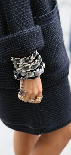 Chanel bracelet catches your eye. Really easy to copy the idea and make one of your own: chain from the hardware store and chiffon/silk ribbon a leftover material or a scarf from the fleamarket.,