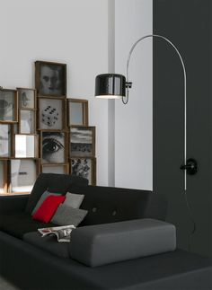 Objects:   Coupé by Oluce, the iconic lamp wins the 2016 Design Award |  The 2016 Best Reissue Design Award was given to the iconic lamp by Joe Colombo or to be more precise, to its wall-mounted rendition Coupé 1159/R. |